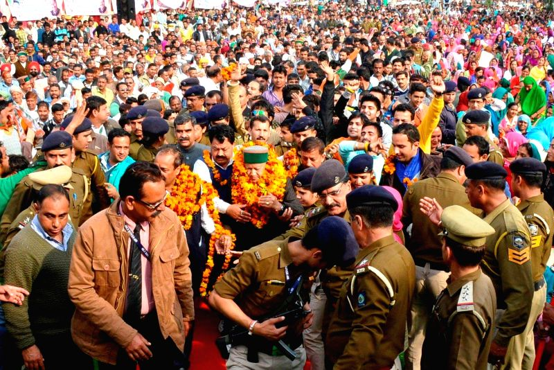 Himachal Pradesh Chief Minister Virbhadra Singh being welcomed on his arrival at Nurpur in Kangra district of the state on Feb 23, 2015. - Virbhadra Singh