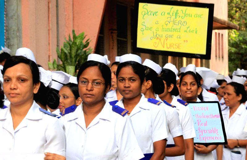 Nurses participate in a rally at J J Hospital of Mumbai on International Nurses Day in Mumbai on May 12, 2014.