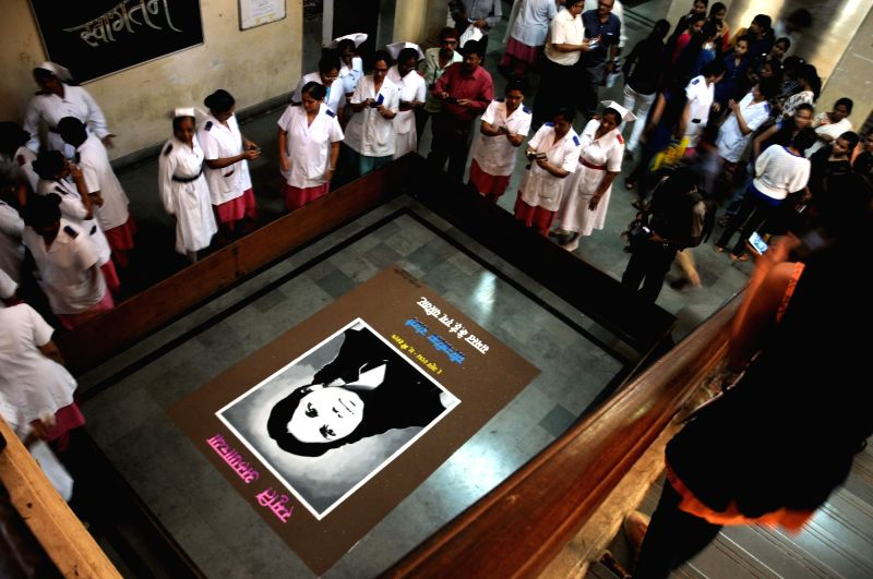 Nurses pay tribute to Aruna Shanbaug - world's oldest comatose patient, who died in Mumbai's KEM Hospital on 18th May 2015 after remaining in coma for almost 42 years - on her death ...