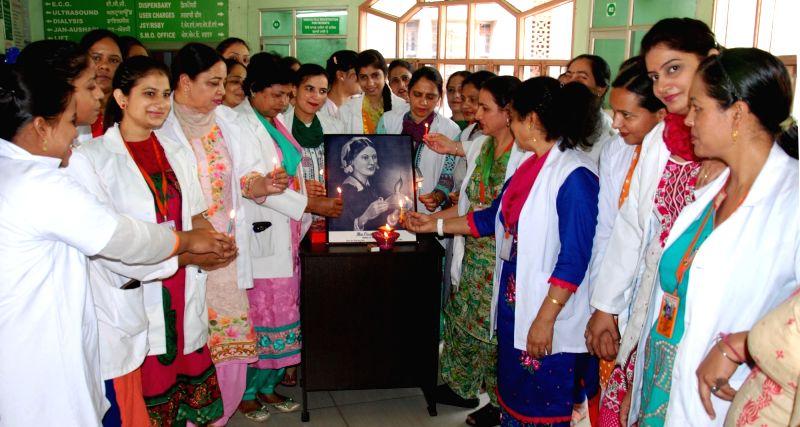 Nursing students observe International Nurses Day in Amritsar, on May 12, 2017.