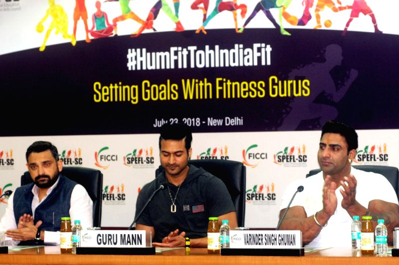 Nutritionist and fitness professional Guru Mann and bodybuilder Varinder Singh Ghuman during awareness programme '#HumFitTohIndiaFit', in New Delhi on July 23, 2018. - Varinder Singh Ghuman