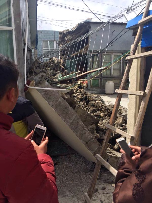 Houses collapse in Nyalam County of Xigaze Prefecture, southwest China's Tibet Autonomous Region, due to an 8.1-magnitude earthquake in Nepal, April 25, 2015. An ...