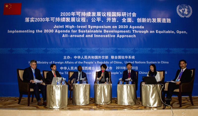 NYINGCHI, May 30, 2016 - Guests attend a joint high-level symposium on 2030 Agenda in Nyingchi, southwest China's Tibet Autonomous Region, May 30, 2016. The theme of the symposium is ...