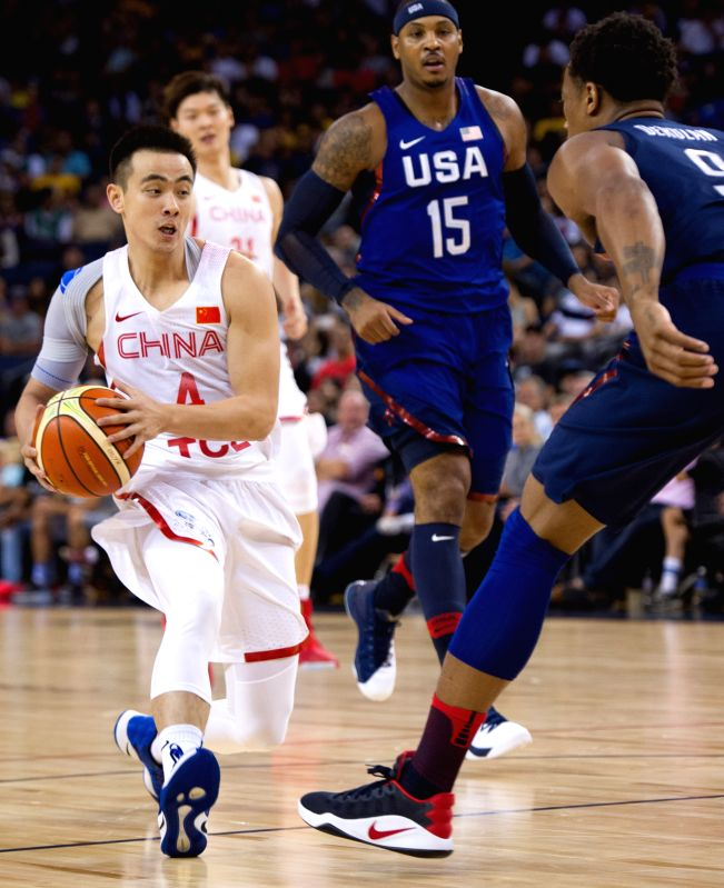 OAKLAND, July 27, 2016 - Zhao Jiwei (L) of China drives the ball under pressure by DeMar DeRozan of the USA during a friendly match at the Oracle Arena in Oakland, California, the United States, July ...