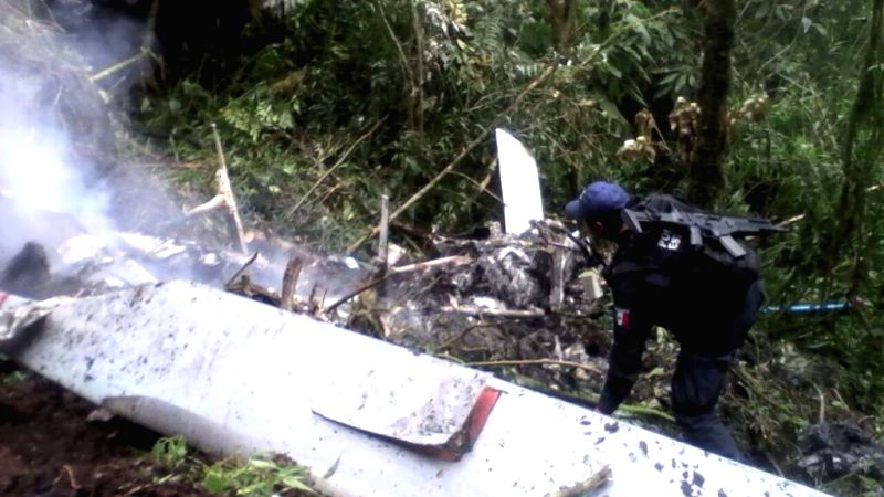 Photo taken with a mobile phone shows the crash site of a helicopter in Santa Maria Chilchota municipality, Oaxaca state, south of Mexico, March 27, 2015. According ...