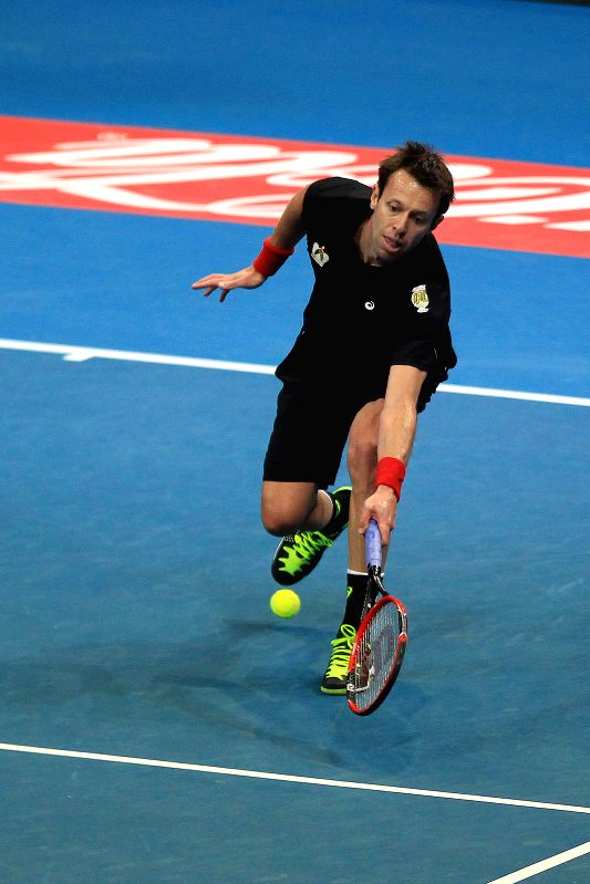 Obi UAE Royals' player Daniel Nestor of Canada returns the ball against the OUE Singapore Slammers' player during their mixed doubles match in the International ...