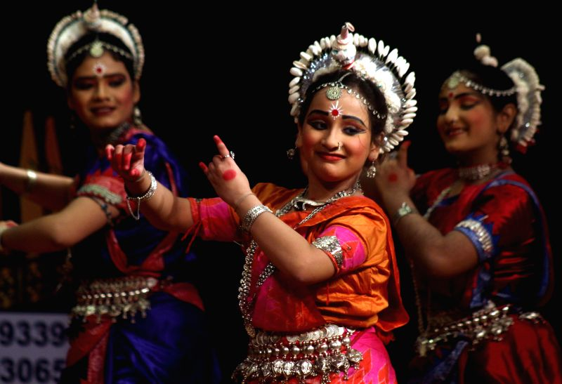 Odisha activists perform during an All India Play, Music and Dance competition USSN Academy at Kalibari hall in Shimla on July 29, 2015.
