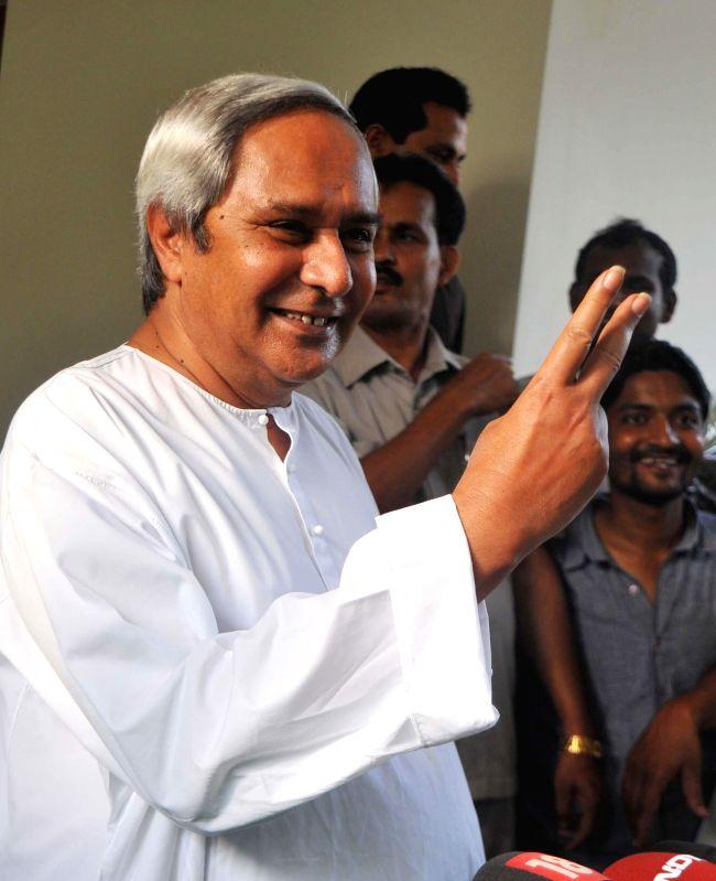Odisha Chief Minister and BJD chief Naveen Patnaik shows victory sign for his party's performance in 2014 Lok Sabha elections in Bhubaneswar on May 16, 2014. (Photo : Arabinda Mahapatra/IANS)
