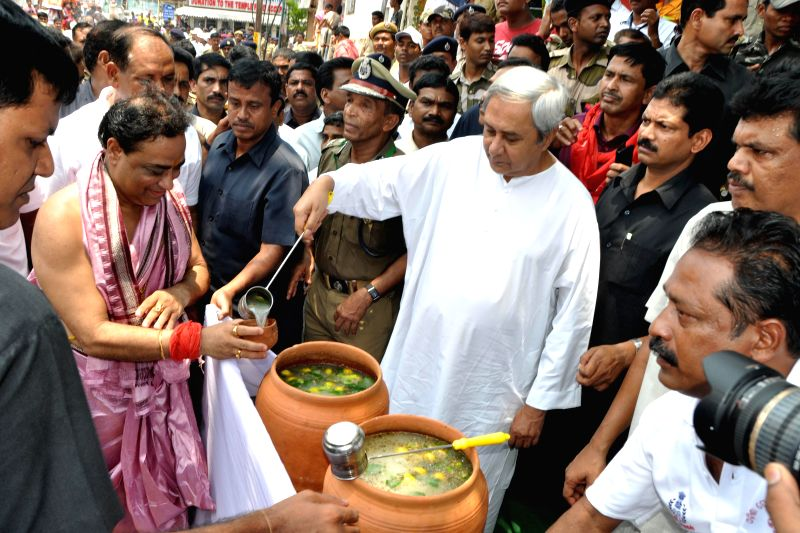 Odisha Chief Minister Naveen Patnaik distributes tanka torani during `rath yatra` (chariot procession) in Puri on June 29, 2014. (Photo : IANS) - Naveen Patnaik