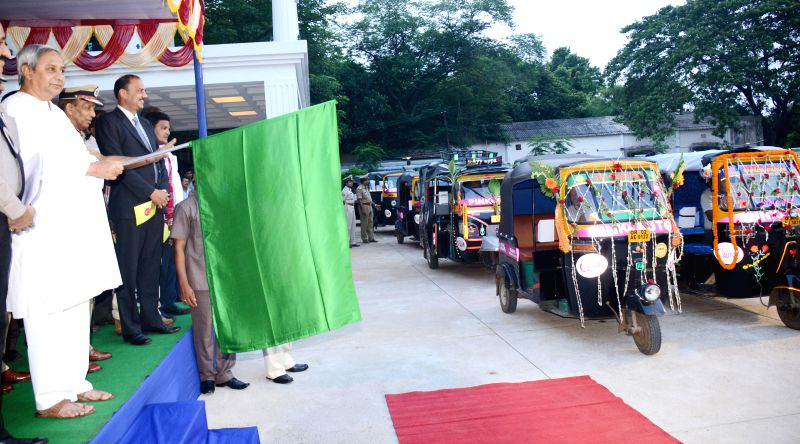 Odisha Chief Minister Naveen Patnaik flags-off a fleet of `pink autos`for women commuters in Bhubaneswar on June 27, 2014. (Photo : Arabinda Mahapatra/IANS) - Naveen Patnaik