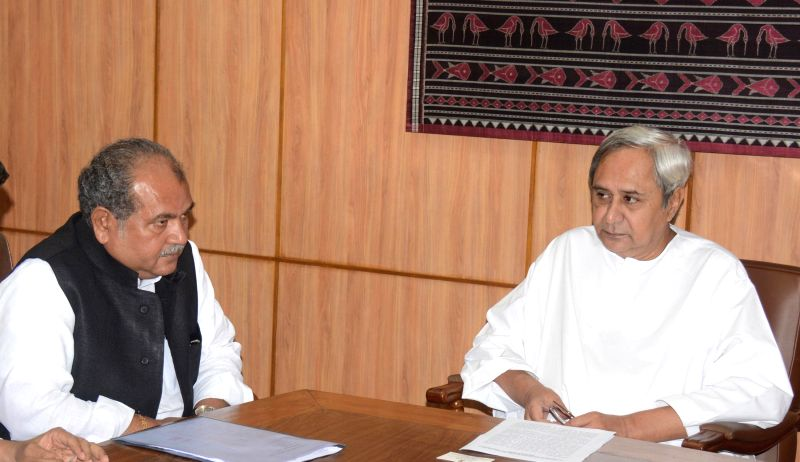 Odisha Chief Minister Naveen Patnaik meets Union Minister for Mines, Steel and Labour & Employment Narendra Singh Tomar, in Bhubaneswar on August 27, 2014.