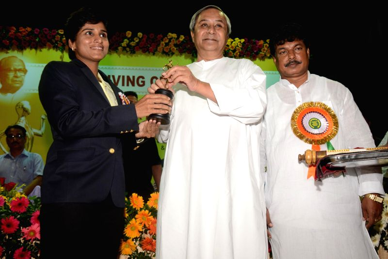 Odisha Chief Minister Naveen Patnaik presents Biju Patnaik Award for Life Time Achievement in Promotion of Sports and Games-2010 to Rachita Homyar Mistry in Bhubaneswar on Aug 29, 2014. (Photo : ... - Naveen Patnaik