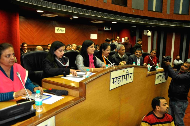 Officials during MCD Council general meeting over sealing drive in New Delhi on Jan 27, 2018.