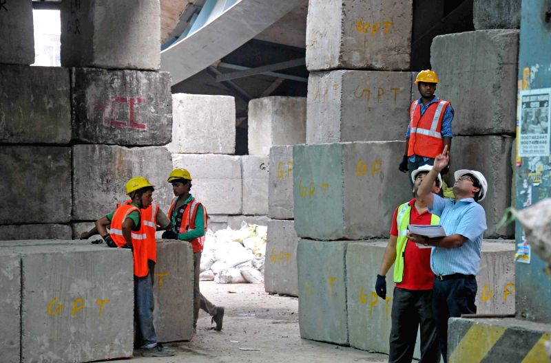 Officials inspect the site where a portion of Vivekananda flyover collapsed in Kolkata, on April 6, 2016.