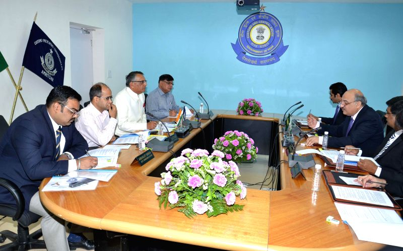 Officials of Indian and Pakistan Customs department holding meeting for better coordination at border between two departments, at Amritsar on April 17, 2014.