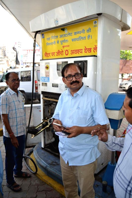 Officials raid a petrol pump to check the sudden spurt of petrol theft in Varanasi on May 6, 2017.