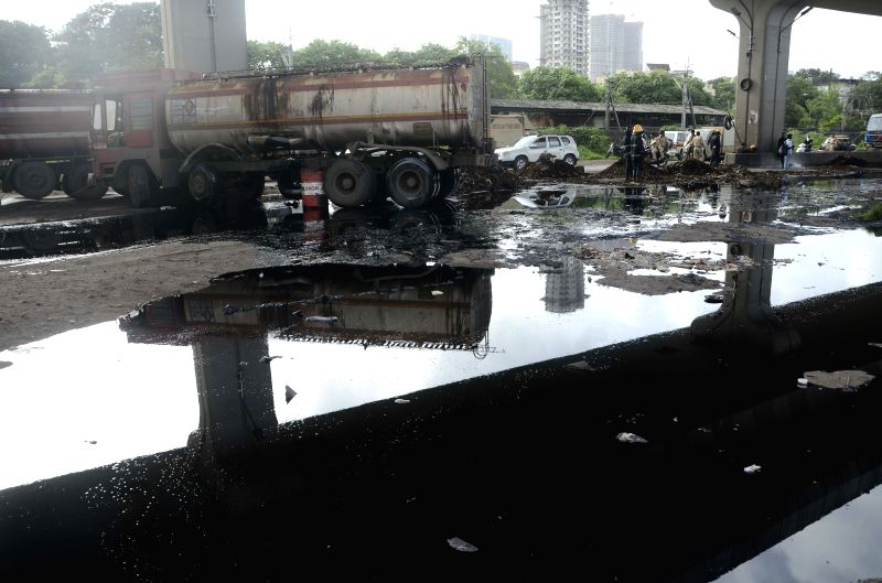 Oil spilled on the ground after an oil rake belonging to Bombay Port Trust rammed into an oil tanker at Sewri, Mumbai on July 14, 2015.