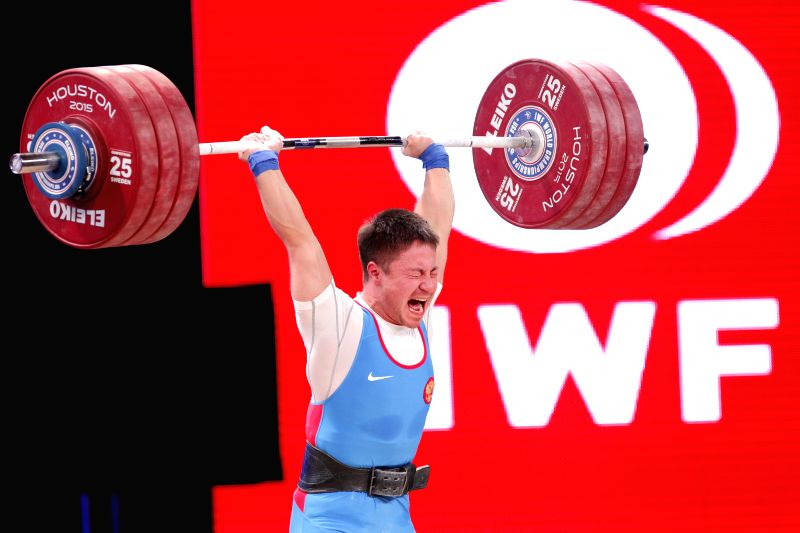 Oleg Chen of Russia competes during the men's 69kg weight class in the 2015 International Weightlifting Federation World Championships in Houston, the United ...