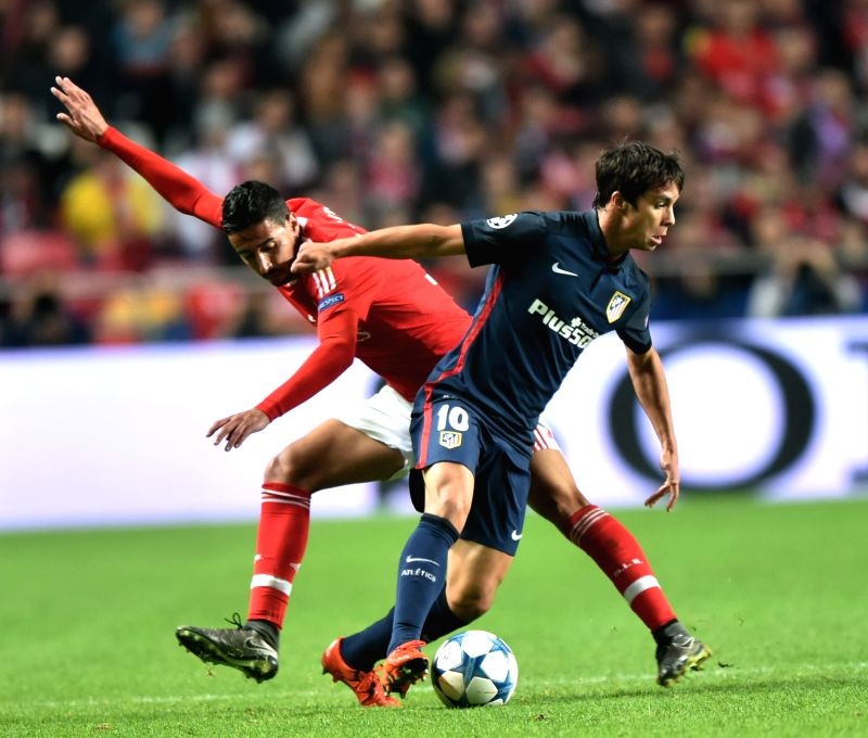 Oliver Torres (R) of Atletico de Madrid and Andre Almeida of Benfica during the UEFA Champions League Group C football match in Lisbon, Portugal, Dec. 8, 2015. ...
