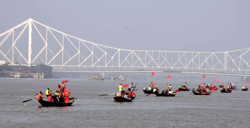 CPI (M) workers head towards Nabanno during a demonstration on the Hooghly river near Kolkata on Dec 16, 2014.