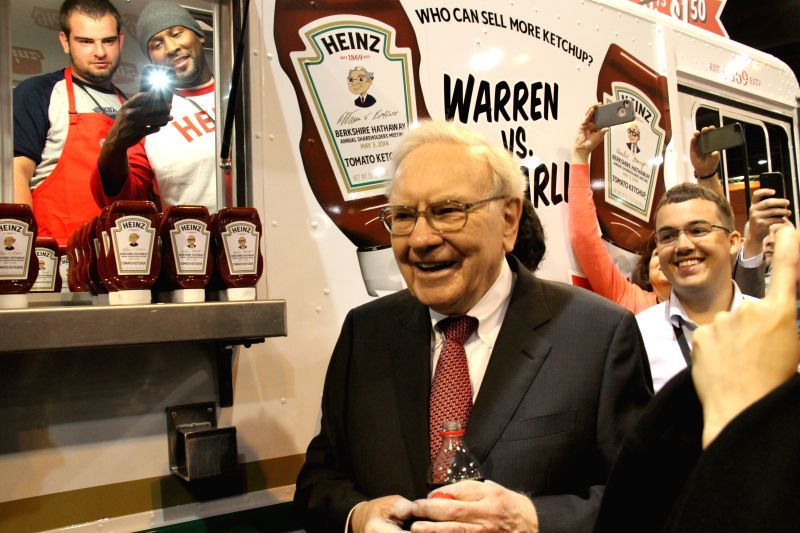 Warren Buffett, chairman of Berkshire Hathaway, introduces products to shareholders before the annual shareholders' meeting of Berkshire Hathaway in Omaha, the United ..