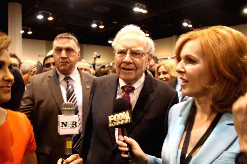 Warren Buffett, chairman of Berkshire Hathaway, is interviewed by media before the annual shareholders' meeting of Berkshire Hathaway in Omaha, the United States, May ..