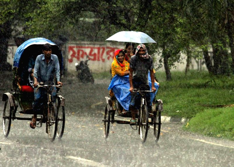 On the third day of monsoon season, a brief spell of rain brings relief to the Dhaka residents in Dhaka, Bangladesh on June 17, 2014.