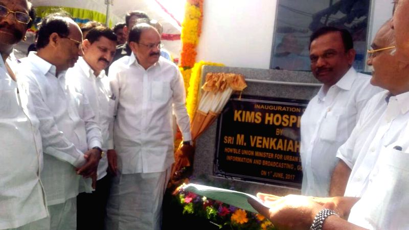 Ongole (Andhra Pradesh): Union Minister for Urban Development, Housing & Urban Poverty Alleviation and Information & Broadcasting M. Venkaiah Naidu unveils the plaque to inaugurate the KIMS ... - M. Venkaiah Naidu
