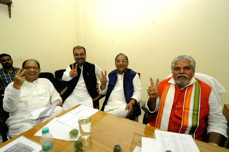 Opposition leader Prem Kumar along with other legislators come out after casting their votes during the presidential polls at Bihar Assembly in Patna on July 17, 2017. - Prem Kumar