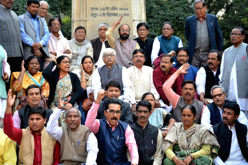 Opposition leaders from Congress and Left MLAs stage a demonstration after walking out from the house against the speaker's decision in the proceedings at West Bengal Legislative Assembly in ...