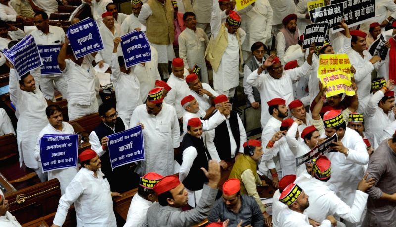 Opposition legislators disrupt the proceedings of Uttar Pradesh Assembly in Lucknow on May 15, 2017.