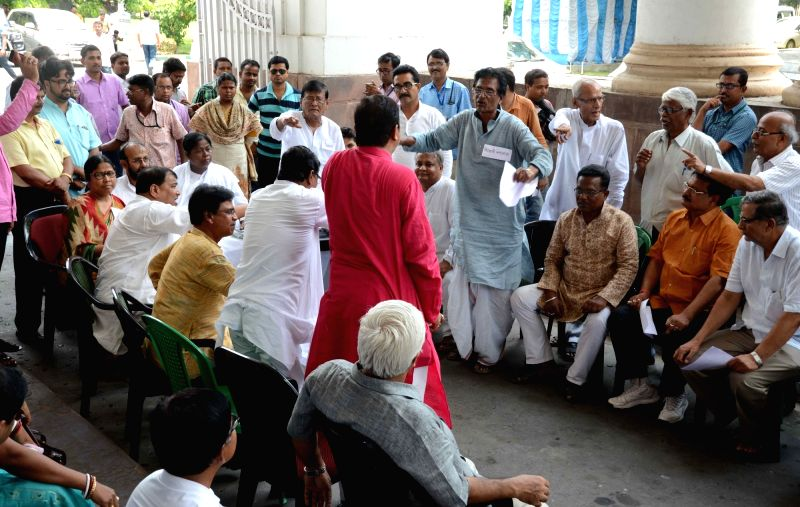 Opposition legislators organise a mock house session against West Bengal Government outside the state assembly in Kolkata, on May 25, 2017.