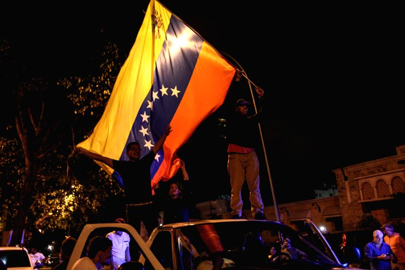 Opposition supporters celebrate the results in Caracas, Venezuela, on Dec. 7, 2015. Venezuela's opposition coalition won a majority in parliament during legislative ...