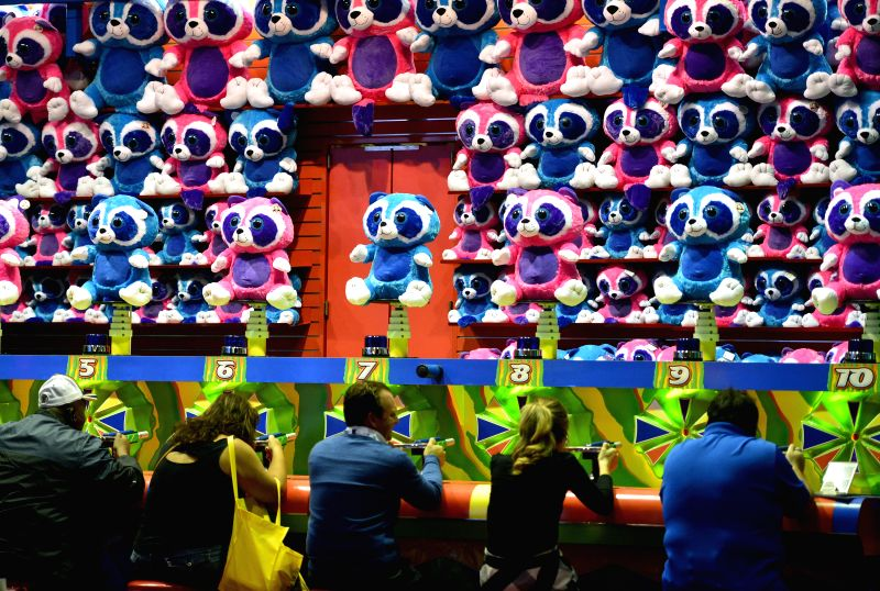 Orlando (U.S.): People visit the International Association of Amusement Parks and Attractions (IAAPA) Attractions Expo 2014 in Orlando, Florida, the United States, Nov. 18, 2014. IAAPA Attractions ...