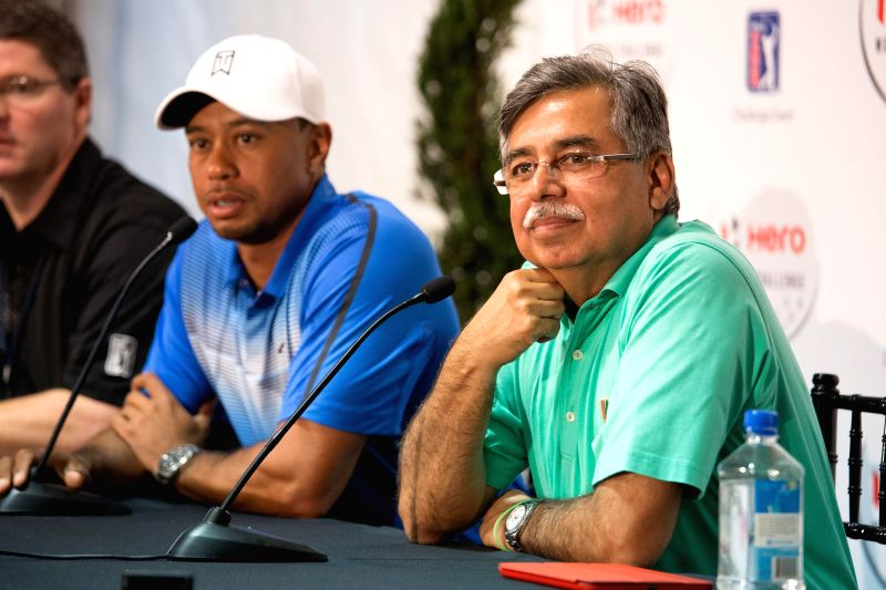 Vice-Chairman and Managing Director of Hero MotoCorp Ltd. Pawan Munjal with company's first Global Corporate Partner, Tiger Woods in Orlando, Florida, United States on Dec 2, 2014.