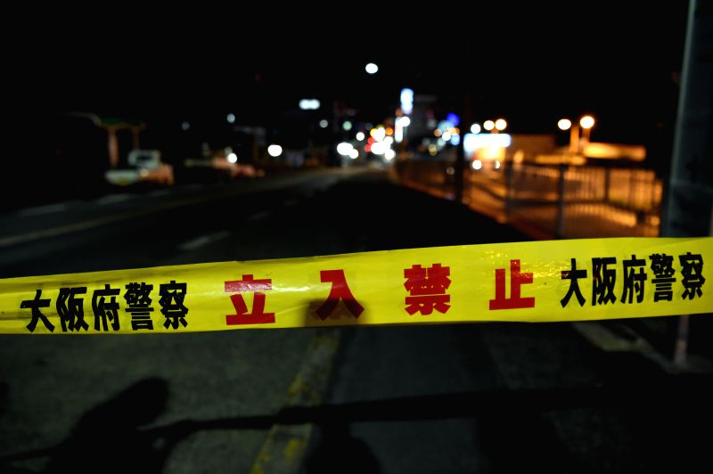 OSAKA, June 18, 2018 - A site of a damaged road is blocked in Osaka, Japan, on June 18, 2018. At least three people have been confirmed dead and more than 90 others injured as a result of a 6.1 ...