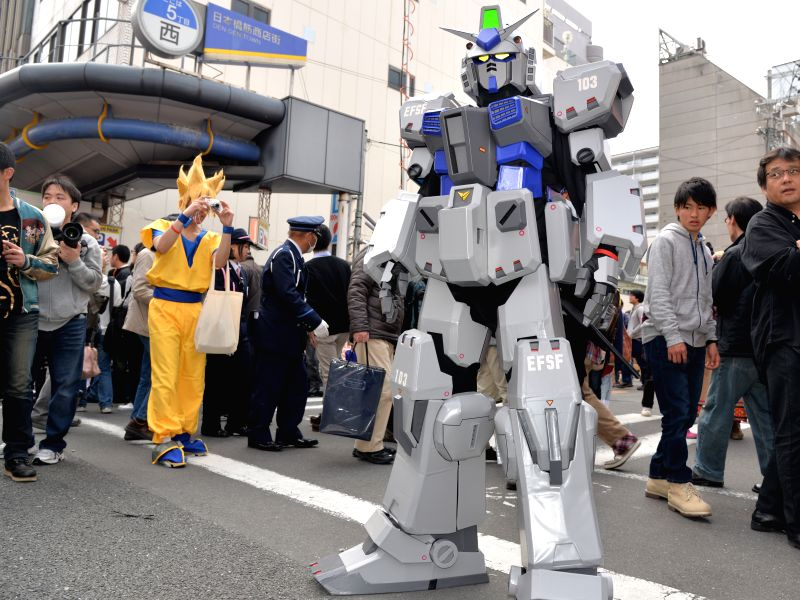 Cosplayers pose during the Nippombashi Street Festa in Osaka, Japan, March 21, 2015. The 11th Nippombashi Street Festa held here on Saturday attracted thousands of ...