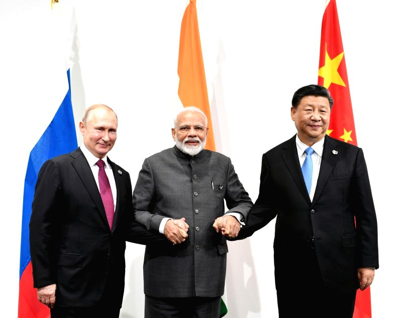 Osaka: Prime Minister Narendra Modi with Chinese President Xi Jinping and Russian President Vladimir Putin during the informal meeting between Russia, India and China (RIC), on the sidelines of the G-20 Summit, in Osaka, Japan on June 28, 2019. (Phot