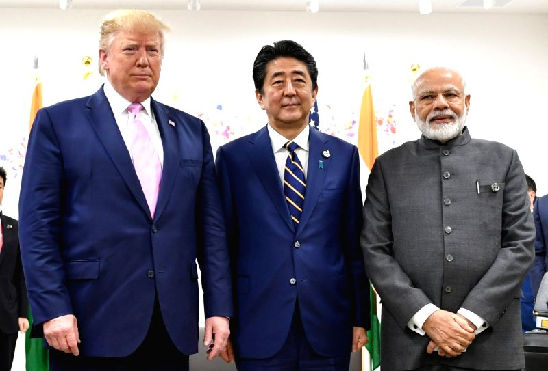 Osaka: Prime Minister Narendra Modi with Japanese Prime Minister Shinzo Abe and US President Donald Trump in a Trilateral Meeting of JAI (Japan-America-India), in Osaka, Japan  on June 28, 2019. (Photo: IANS/PIB)
