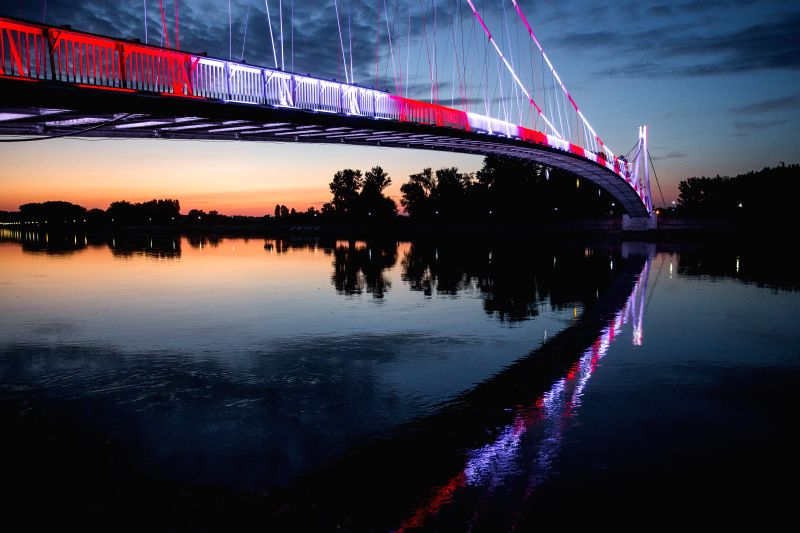 OSIJEK, July 14, 2018 - Photo taken on July 13, 2018 in Osijek, Croatia shows a pedestrian bridge illuminated in red and white to support the Croatian national soccer team ahead of the FIFA World Cup ...
