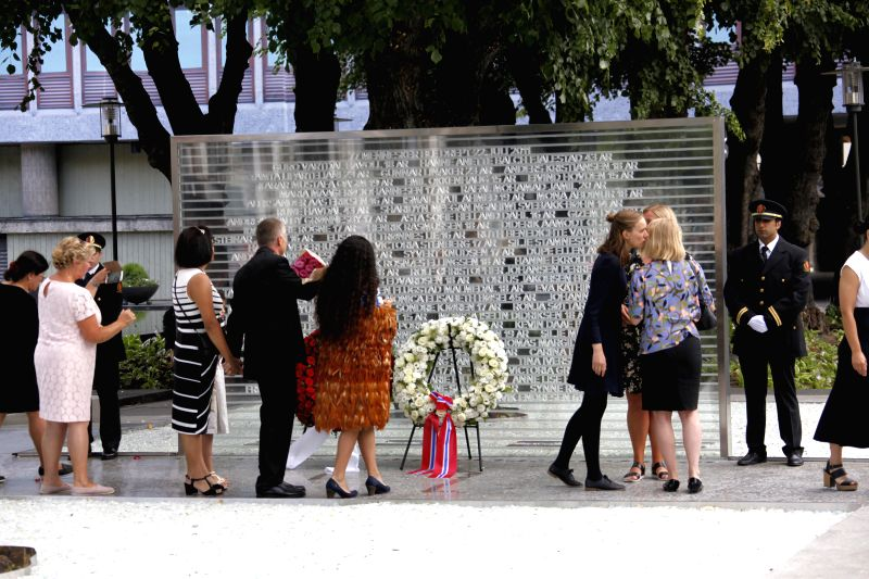OSLO, July 22, 2018 - People pay tribute to the victims of the July 22 attacks in 2011 at a temporary memorial in Oslo, Norway, July 22, 2018. A temporary memorial was unveiled on the seventh ...