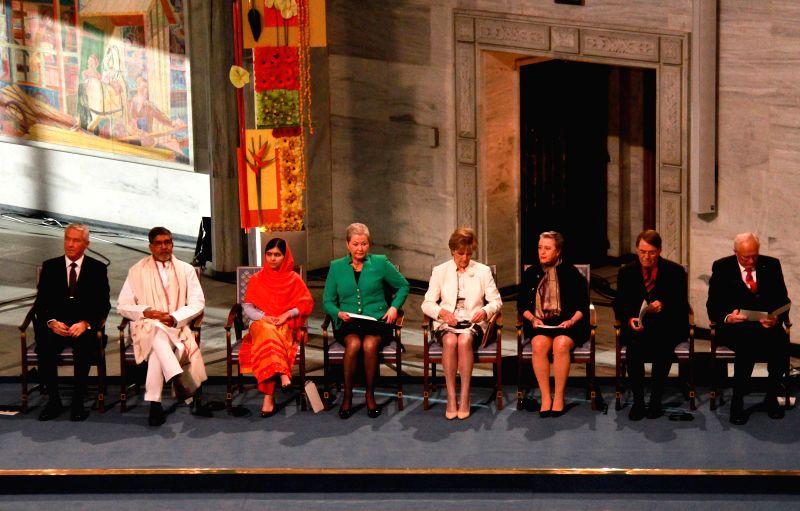 Oslo (Norway): Kailash Satyarthi (2nd L) and Malala Yousafzai (3rd L) attend the Nobel Peace Prize awarding ceremony in Oslo, Norway, Dec. 10, 2014. Kailash Satyarthi and Malala Yousafzai, two child .