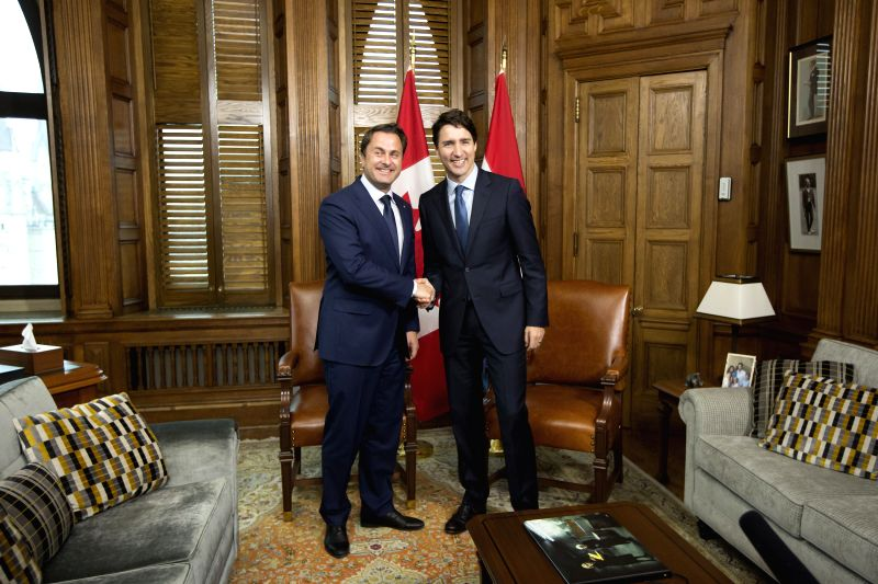 OTTAWA, April 19, 2017 - Canadian Prime Minister Justin Trudeau (R) shakes hands with visiting Luxembourg's Prime Minister Xavier Bettel during their meeting at Trudeau's office on Parliament Hill in ... - Justin Trudeau