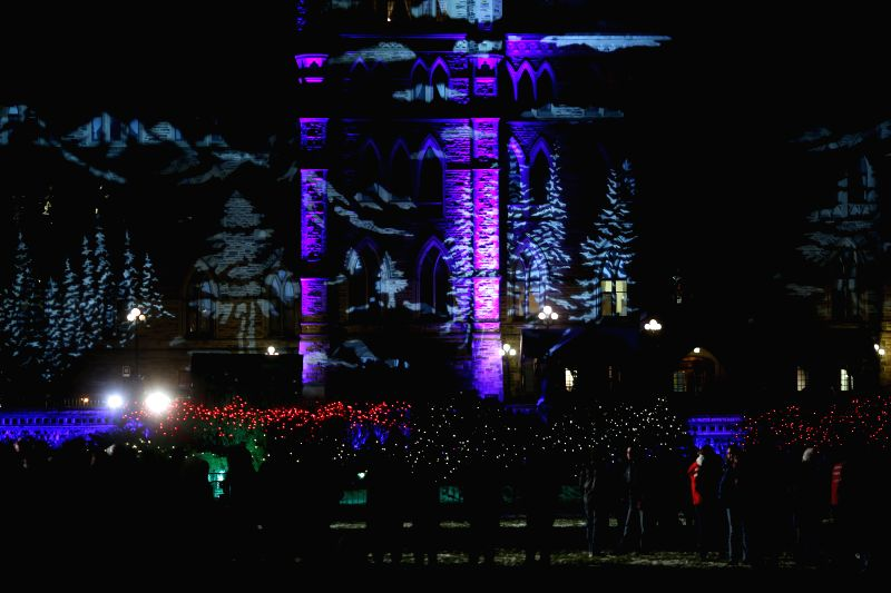 Ottawa (Canada): People from cities across Canada gather in Ottawa for the 30th annual Christmas Lights Across Canada program, which sees Parliament Hill illuminated for the holidays in Ottawa, ...