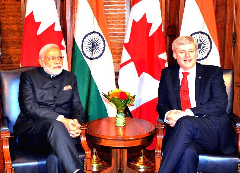 Ottawa (Canada): Prime Minister Narendra Modi during a meeting with  the Prime Minister of Canada, the Right Honourable Stephen Harper at Parliament Hill, in Ottawa, Canada on April 15, 2015. - Narendra Modi