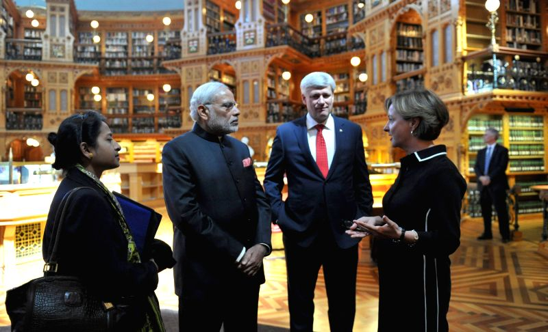 Ottawa (Canada): Prime Minister Narendra Modi visits the library of Canadian Parliament with the Prime Minister of Canada, the Right Honourable Stephen Harper, in Ottawa, Canada on April 15, 2015. - Narendra Modi
