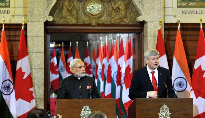Ottawa (Canada): Prime Minister, Narendra Modi with the Canadian Prime Minister, the Right Honourable Stephen Harper, during the joint press conference, in Ottawa, Canada on April 15, 2015. - Narendra Modi