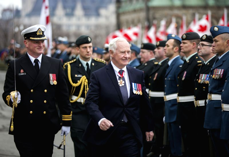 OTTAWA, Dec. 4 Canadian Governor General David Johnston reviews the guard of honor upon his arrival to the Throne Speech at Parliament Hill in Ottawa, Canada, Dec. 4, 2015. The Throne ...
