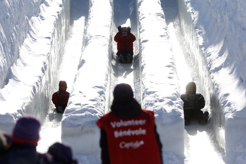 Children and adults enjoy the ice slides in Jacques Cartier Park on the opening day of Winterlude, in Ottawa, Canada on Jan. 31, 2015. Winterlude, the National ...