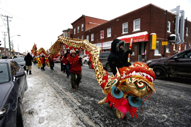 Members of the Chinese community perform during the annual Lion Dance parade to celebrate the Chinese Lunar New Year along Somerset Street in Ottawa's Chinatown, ...